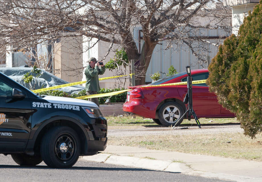 Police investigators take pictures and gather evidence 01/23/2020 in the 1900 block of E. Pine following an officer involved shooting. Tim Fischer/Reporter-Telegram Photo: Tim Fischer/Midland Reporter-Telegram / Midland Reporter-Telegram
