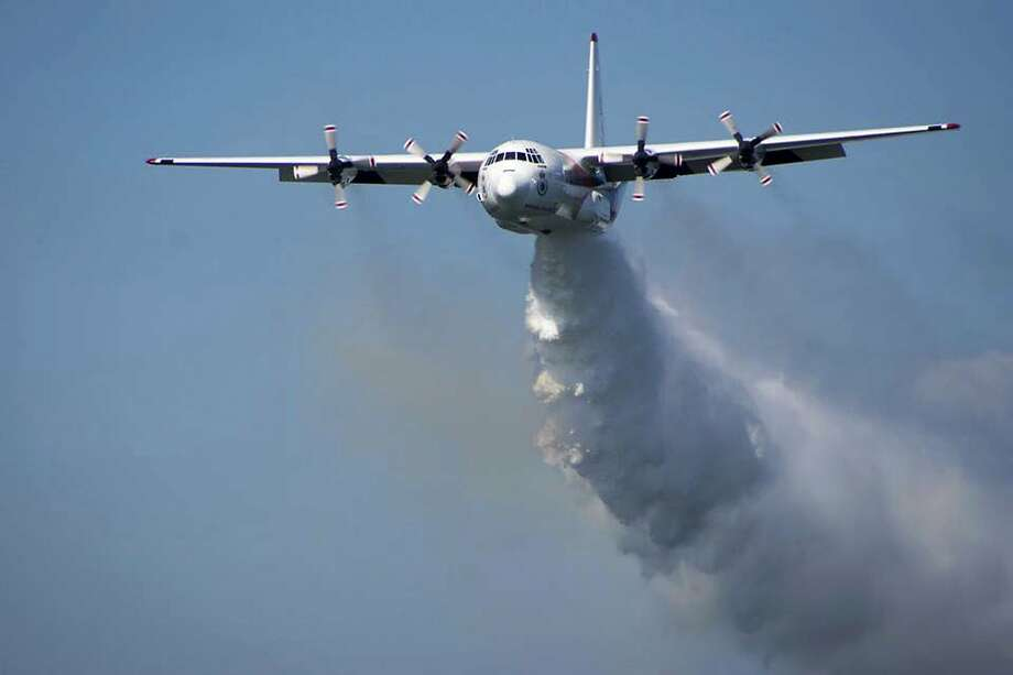 The U.S. firefighters were in a C-130 Hercules aerial water tanker like this one when it crashed in southeastern Australia. Photo: Rural Fire Service