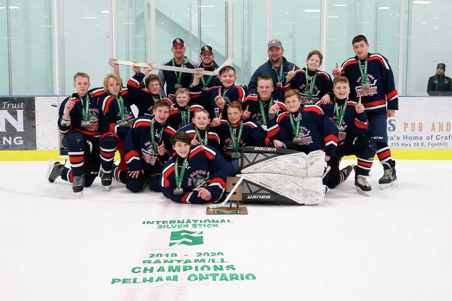 The Big Rapids Ice Dogs: from Left to right: Carter Leyder, Logan Leyder, Brogan Jones, Preston Younge, Bobby Lilly, Tyler Blanchard, Nicholas Pischel, Eil Shields, Jack Balahoski, Charles Montgomery, Ethan Voigt, Brayden Olds, Caleb Speese and Brenton Cinco; back, coaches; Garrett Blanchard, Mike Grant and Tim Leyder.
