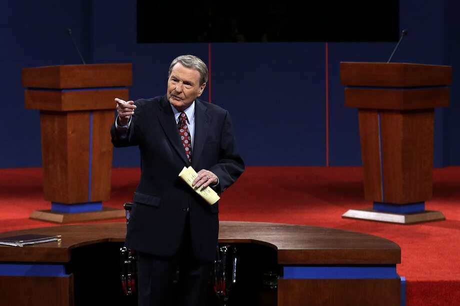Jim Lehrer addresses the audience before the first presidential debate in 2012 at the University of Denver. The PBS news anchor moderated 11 presidential debates from 1988 to 2012. Photo: Charlie Neibergall / Associated Press 2012