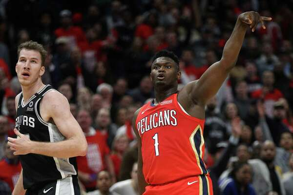 NEW ORLEANS, LOUISIANA - JANUARY 22: Zion Williamson #1 of the New Orleans Pelicans reacts after making a three point shot against the San Antonio Spurs at Smoothie King Center on January 22, 2020 in New Orleans, Louisiana. NOTE TO USER: User expressly acknowledges and agrees that, by downloading and/or using this photograph, user is consenting to the terms and conditions of the Getty Images License Agreement.