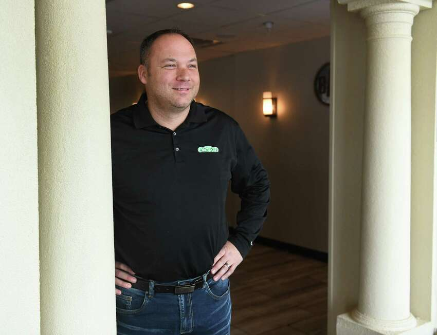 Owner Kris Monforte stands in the doorway to the bar of his restaurant Orchard Tavern West on Wednesday, Jan. 22, 2020 in Guilderland, N.Y. (Lori Van Buren/Times Union)