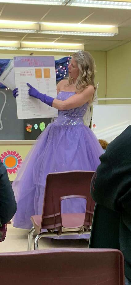 The Toothy Fairy (Northwest Michigan Health Services dental hygienist Jen Kerns) taught children about dental health on Wednesday at Madison Elementary. (Courtesy photo)