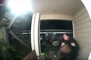 A Ring doorbell camera shows a violent robbery in the Oakland hills Monday night.