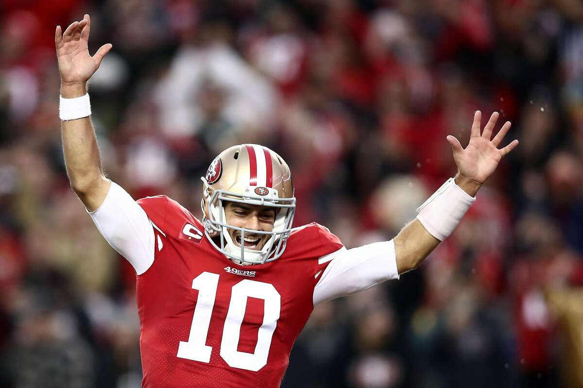 SANTA CLARA, CALIFORNIA - JANUARY 19: Jimmy Garoppolo #10 of the San Francisco 49ers celebrates a touchdown by Raheem Mostert #31 in the second quarter against the Green Bay Packers during the NFC Championship game at Levi's Stadium on January 19, 2020 in Santa Clara, California. (Photo by Ezra Shaw/Getty Images)