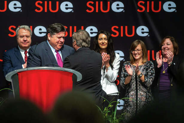 Illinois Gov. J.B. Pritzker is greeted by SIUE Chancellor Randy Pembrook Thursday.
