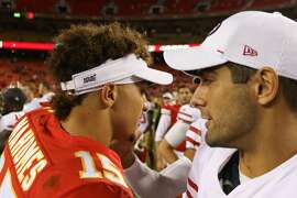 KANSAS CITY, MO - AUGUST 24: Kansas City Chiefs quarterback Patrick Mahomes (15) and San Francisco 49ers quarterback Jimmy Garoppolo (10) exchange a handshake and words after an NFL preseason game between the San Francisco 49ers and Kansas City Chiefs on August 24, 2019 at Arrowhead Stadium in Kansas City, MO.  (Photo by Scott Winters/Icon Sportswire via Getty Images)