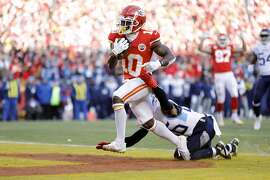 Kansas City Chiefs wide receiver Tyreek Hill (10) scores as Tennessee Titans cornerback Logan Ryan (26) defends during an NFL, AFC Championship football game Sunday, Jan. 19, 2020, in Kansas City, MO. The Chiefs won 35-24 to advance to Super Bowl 54. (AP Photo/Colin E. Braley)