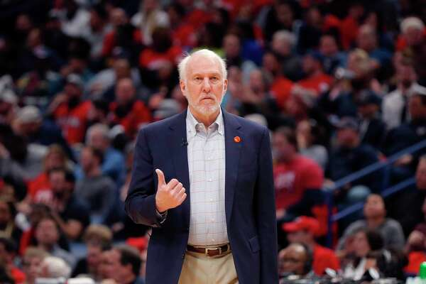 San Antonio Spurs head coach Gregg Popovich walk onto he court after calling a timeout in the second half of an NBA basketball game against the New Orleans Pelicans in New Orleans, Wednesday, Jan. 22, 2020. The Spurs won 121-117. (AP Photo/Gerald Herbert)