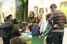 Families enjoy the fun activities at Wilton Library during last year's Winter Carnival. Crafts, green screen photography, and button making are just some of the fun indoor activities planned to warm up from the cold for this year's carnival on Sunday, Jan. 26, beginning at noon.