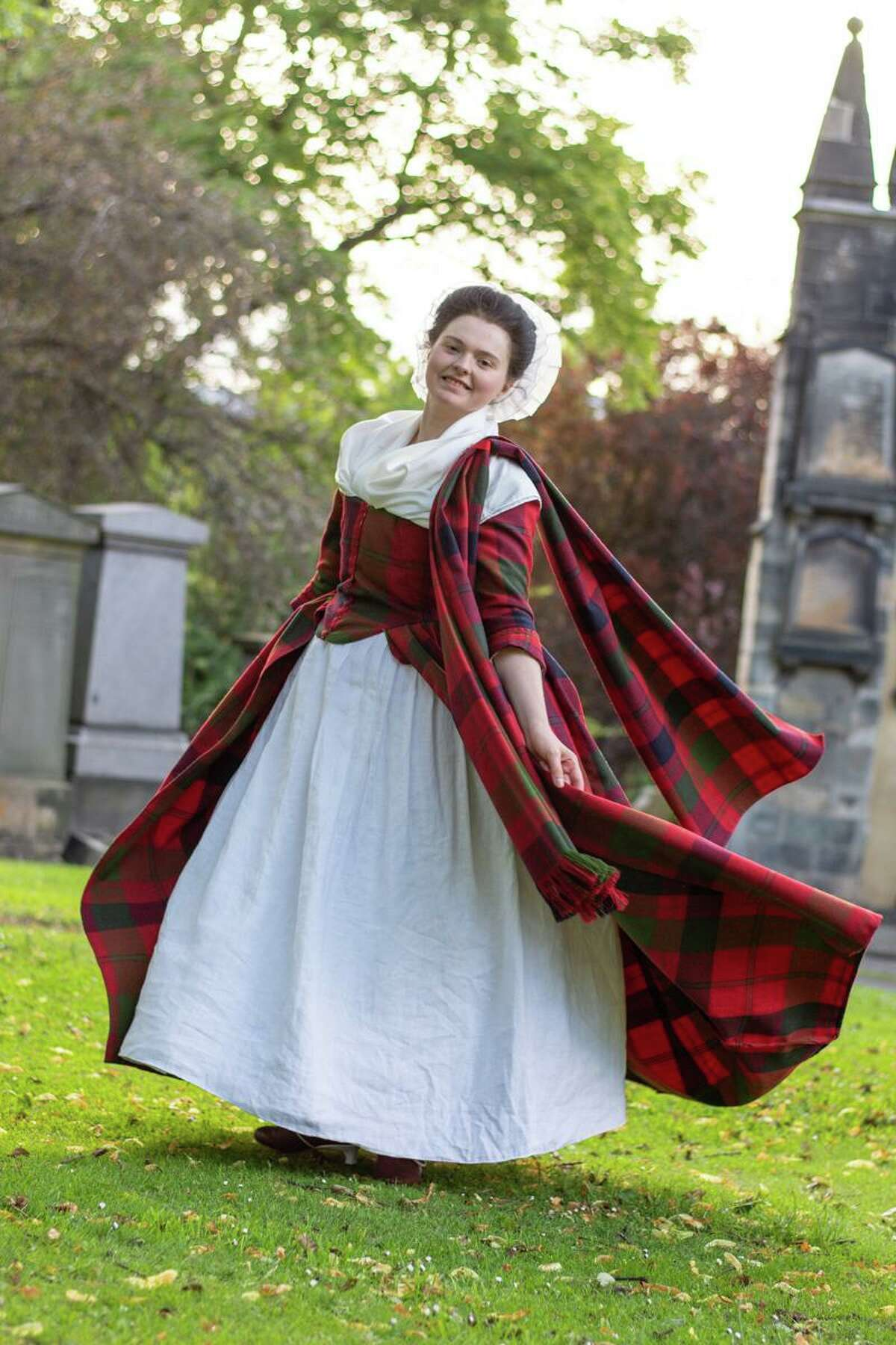 A woman models a re-creation of the Isabella MacTavish Fraser wedding dress by Rebecca Olds, maker of reconstructed clothing of the 18th-century for film and reenactments.