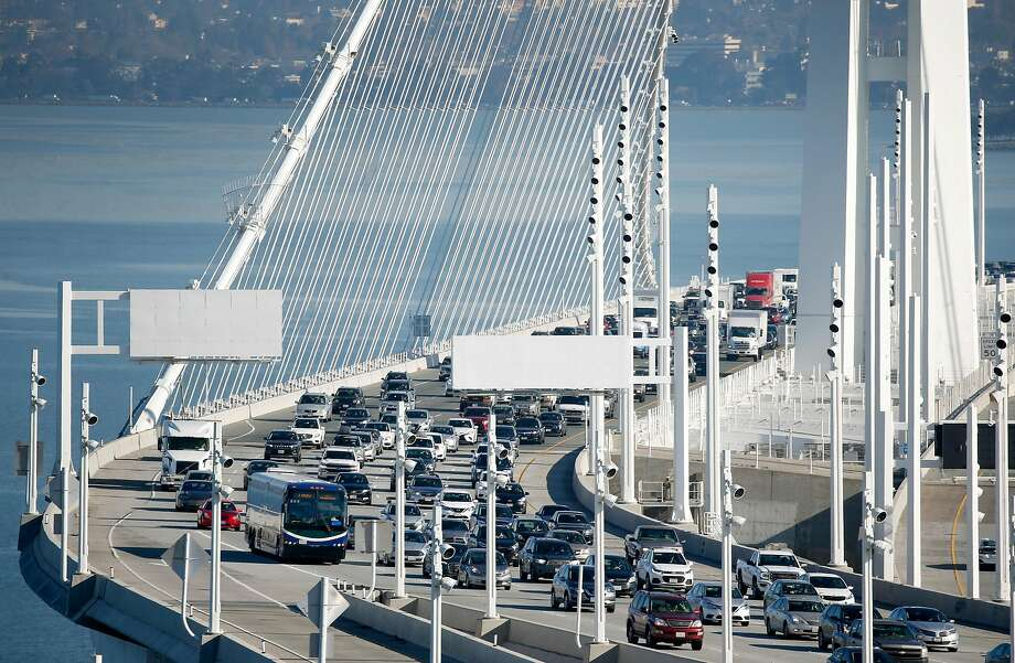 A WestCAT Lynx commuter bus approaches the Yerba Buena Island tunnel on westbound lanes of the Bay Bridge in San Francisco, Calif. on Friday, Jan. 10, 2020. Photo: Paul Chinn / The Chronicle