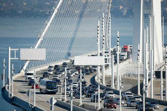 A WestCAT Lynx commuter bus approaches the Yerba Buena Island tunnel on westbound lanes of the Bay Bridge in San Francisco, Calif. on Friday, Jan. 10, 2020. Assemblyman Rob Bonta is floating the idea of dedicating one lane of traffic exclusively for bus use only.