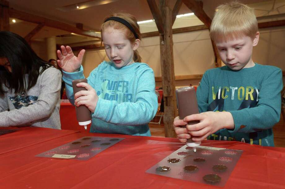 Children may create hand-made molded chocolates and decorated boxes to put them in during the one-hour Valentine's Day chocolate-making workshop on Feb. 8 at the Wilton Historical Society. Photo: Erik Trautmann / Hearst Connecticut Media / Norwalk Hour