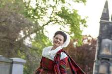 A woman models a recreation of the Isabella MacTavish Fraser wedding dress by Rebecca Olds, maker of reconstructed clothing of the 18th-century for film and reenactments.