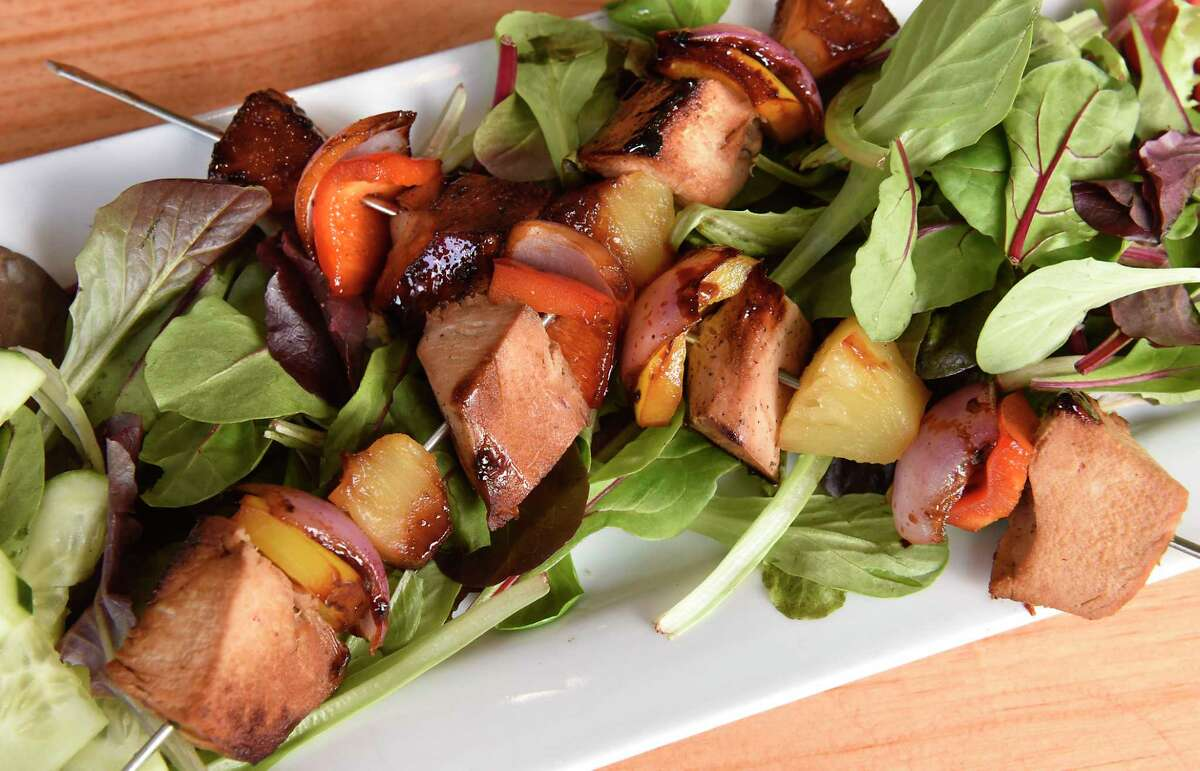 Hawaiian chicken teriyaki skewer - grilled chicken, bell peppers, red onions and pineapple served in a flavorful Hawaiian teriyaki sauce served over greens at Cafe Monocle on Wednesday, Jan. 15, 2020 in Cohoes, N.Y (Lori Van Buren/Times Union)