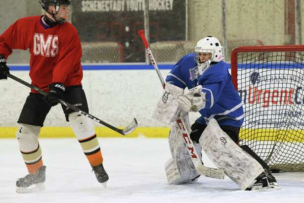 Goalie Ryan McCone is seen in the net as the combined hockey team including players from Guilderland, Mohonasen, Schalmont, Voorheesville, and Scotia-Glenville practices at the Schenectady Country Recreational Facility on Thursday, Jan. 23, 2020 in Schenectady N.Y. (Lori Van Buren/Times Union)