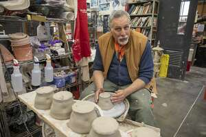 The University of Texas of the Permian Basin ceramics professor Chris Stanley works on bowls for the 2021 Empty Bowls event on Wednesday, Jan. 22 at UTPB. Jacy Lewis/Reporter-Telegram