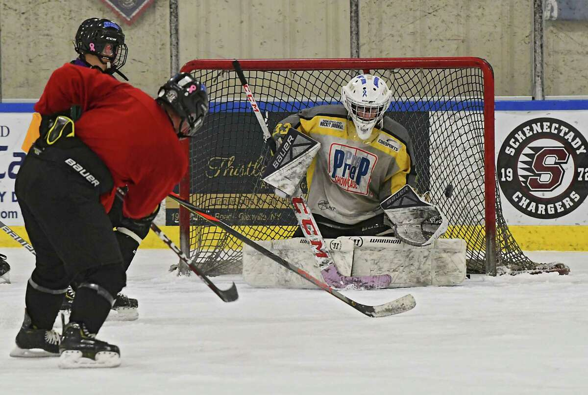 Goalie Angelo Fraley is seen in the net as the combined hockey team including players from Guilderland, Mohonasen, Schalmont, Voorheesville, and Scotia-Glenville practice at the Schenectady Country Recreational Facility on Thursday, Jan. 23, 2020 in Schenectady N.Y. (Lori Van Buren/Times Union)