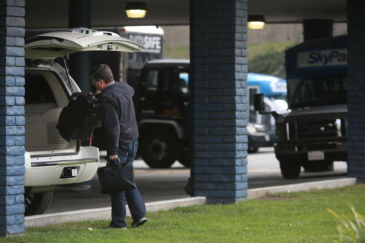 Jim Johnson places his luggage in his car as he picks it up at SkyPark on Thursday, January 23, 2020 in San Bruno, Calif.