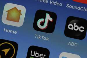 File photo: A photo illustration of the TikTok app, displayed on an iPhone.