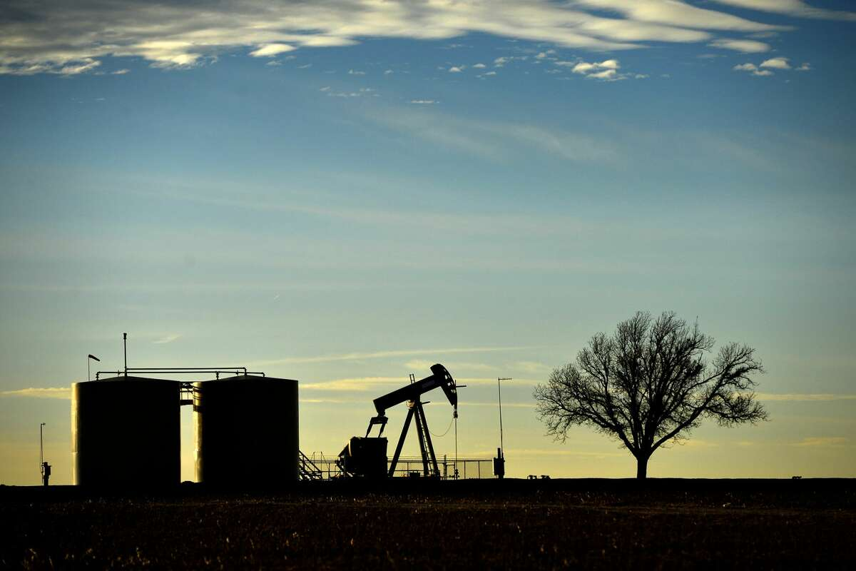 Pumpjack and tank battery operating in Greenwood, Midland County, Texas, Dec. 21, 2018.