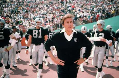 Raiders Coach Tom Flores walks the sidelines before a game in 1987 in Los Angeles' Coliseum. Is the ghost of Al Davis keeping him from the Pro Football Hall of Fame?