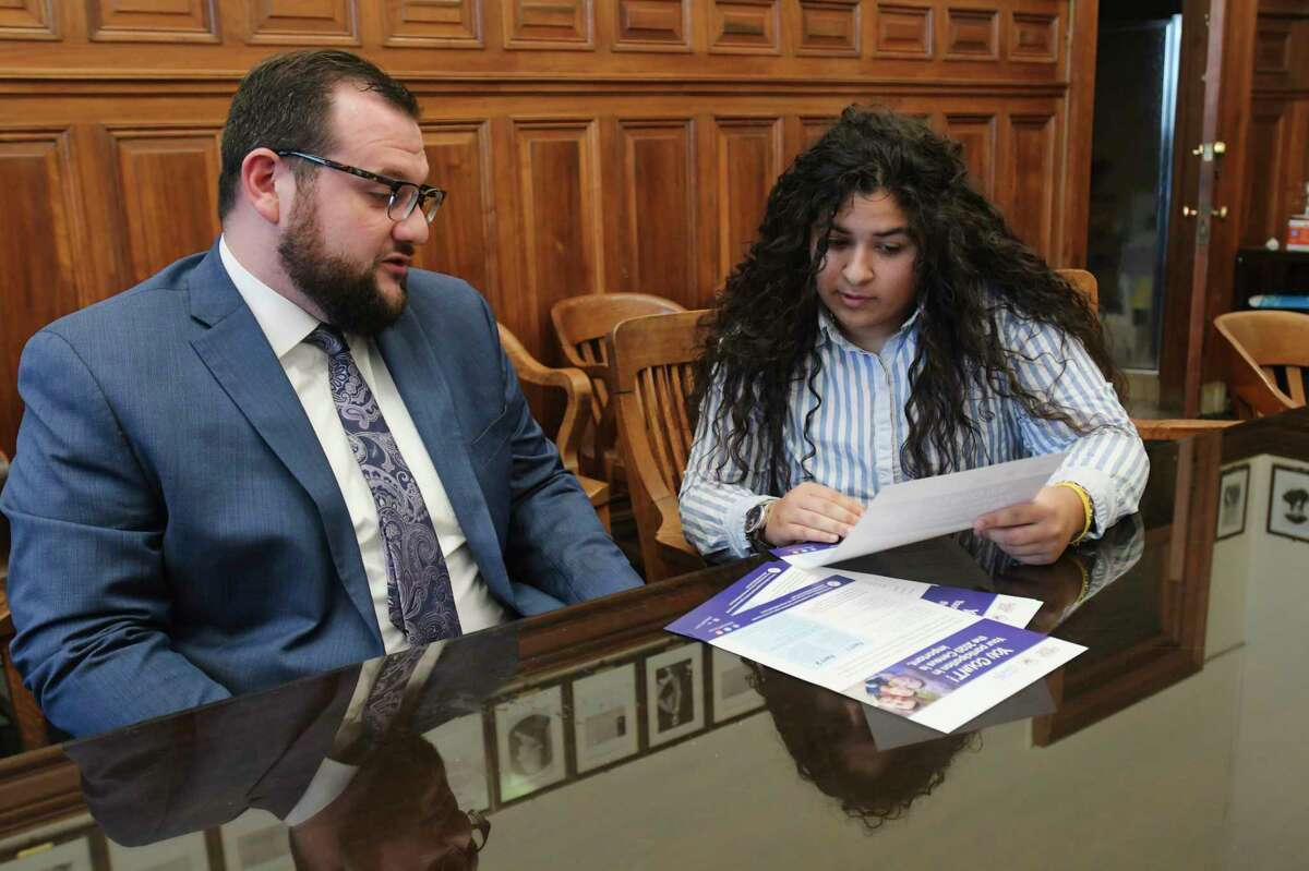 David Galin, left, chief of staff for Albany Mayor Kathy Sheehan, and Jasmine Higgins, City of Albany constituent services assistant, go over an informational flyer for the census at City Hall on Wednesday, Jan. 15, 2020, in Albany, N.Y. (Paul Buckowski/Times Union)