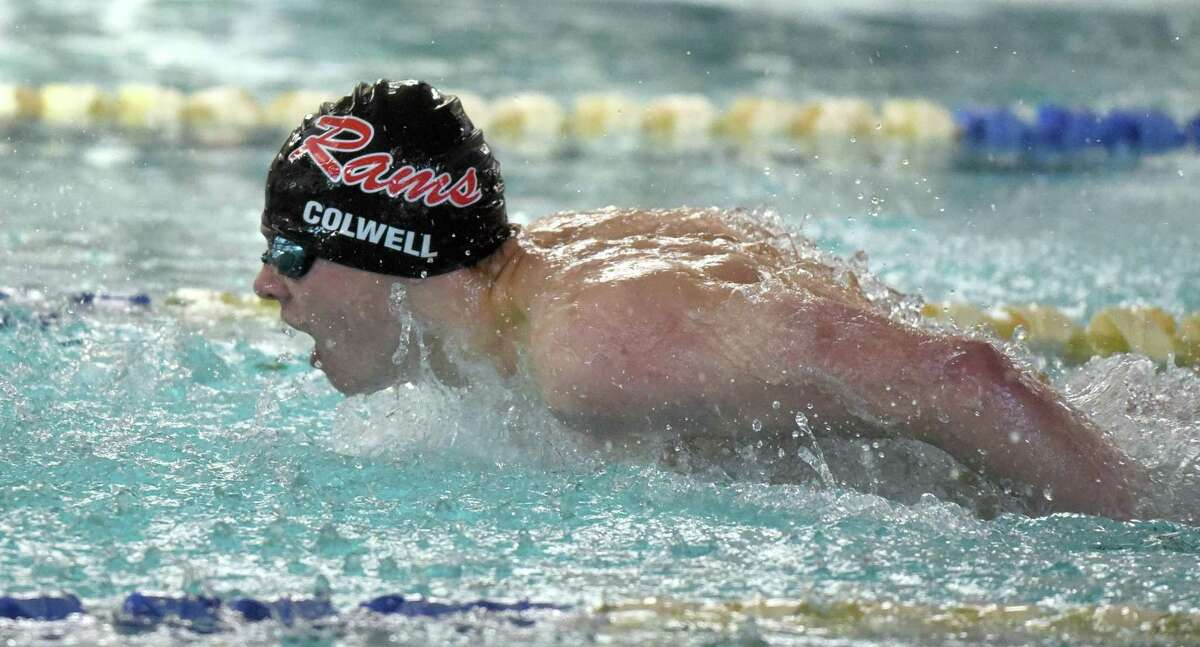 New Canaan's Patrick Colwell swims in the 200 individual medley during the Rams' meet against Darien earlier this month.