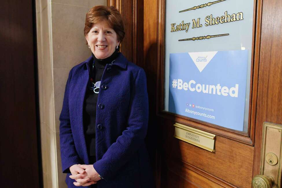 Mayor Kathy Sheehan poses next to a sign promoting the census on the door to her office at City Hall on Wednesday, Jan. 15, 2020, in Albany, N.Y. (Paul Buckowski/Times Union)