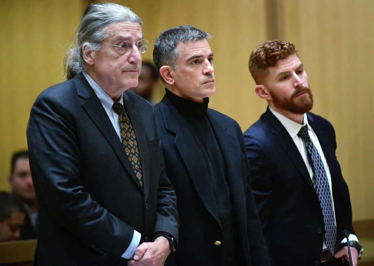 File photo: Fotis Dulos, center, appears in Stamford Superior Court Thursday, January 23, 2020.