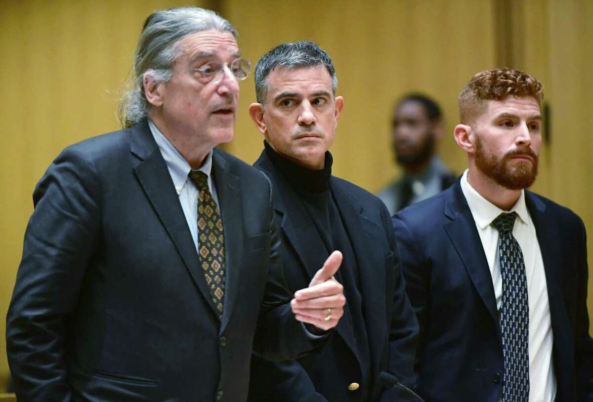 Fotis Dulos, center, appears in Stamford Superior Court Thursday, January 23, 2020, for a probable cause hearing in his murder case with attorneys Norm Pattis, left, and Chris La Tronica in Stamford, Conn.