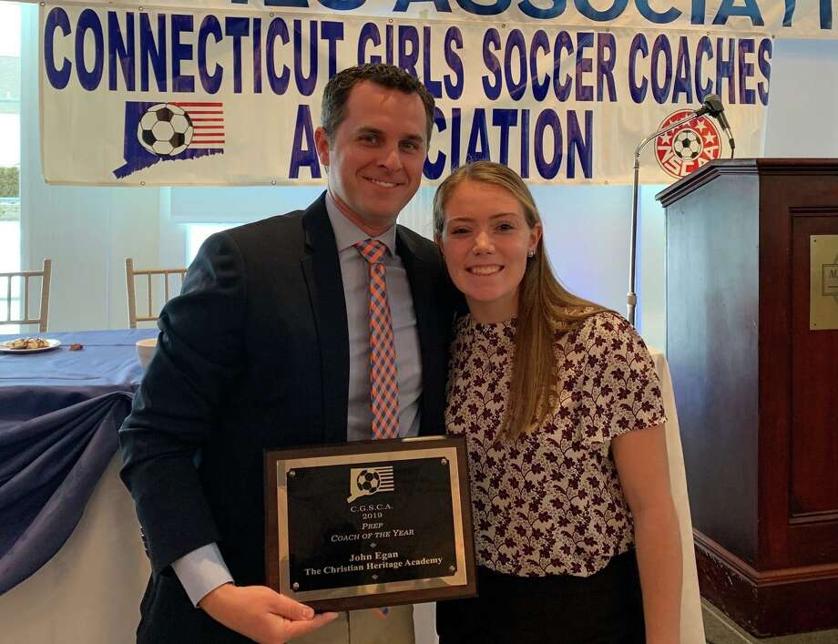 Christian Heritage girls' soccer coach John Egan is joined by Lady Kingsmen junior Jordyn O'Driscoll at the annual Connecticut s Soccer Coaches Association Banquet. Photo: Contributed Photo / Christian Heritage Athletics / Trumbull Times