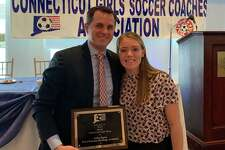 Christian Heritage girls' soccer coach John Egan is joined by Lady Kingsmen junior Jordyn O'Driscoll at the annual Connecticut s Soccer Coaches Association Banquet.