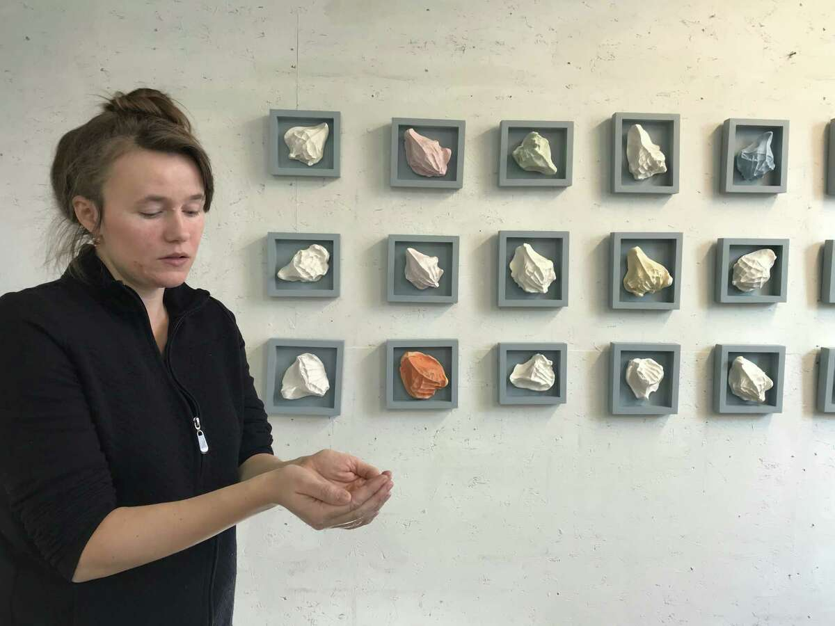 Maryna Bilak with some of her pieces cast from the hands of caregivers (photo by Amy Biancolli)