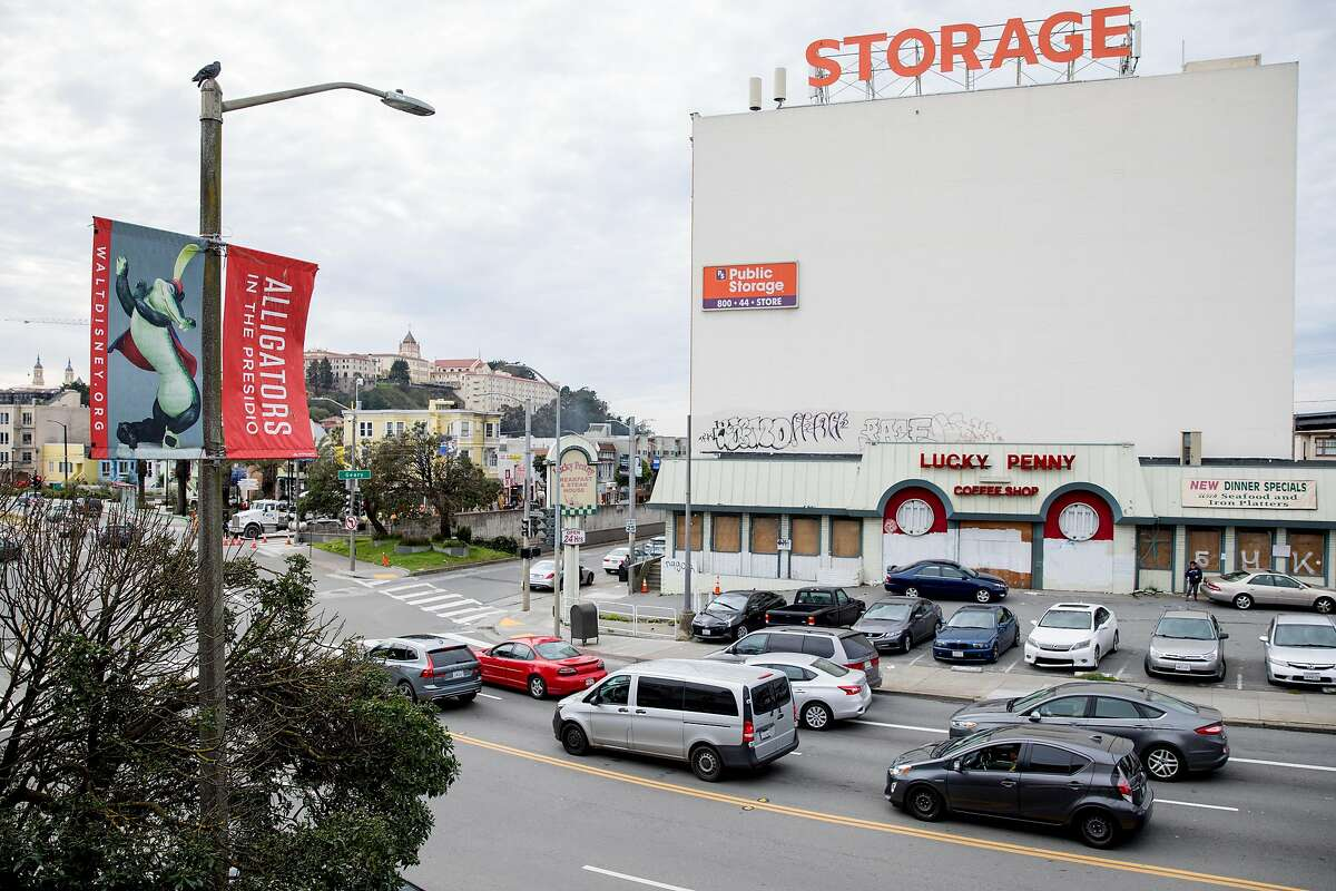 The former Lucky Penny restaurant is seen boarded up and its parking lot used for overflow Trader Joe's parking in San Francisco, Calif. Thursday, Jan. 23, 2020. San Francisco's Planning Commission will decide Thursday, January 23 to build 101 units of housing at the former site of the restaurant near Geary Boulevard and Masonic Avenue.