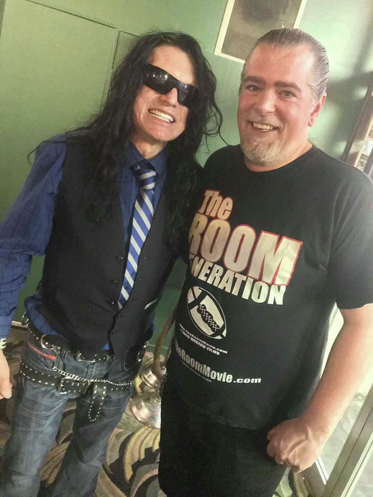 Michael Blythe poses next to Tommy Wiseau, who has appeared at the Clay Theatre on more than one occasion for his ritual screenings of