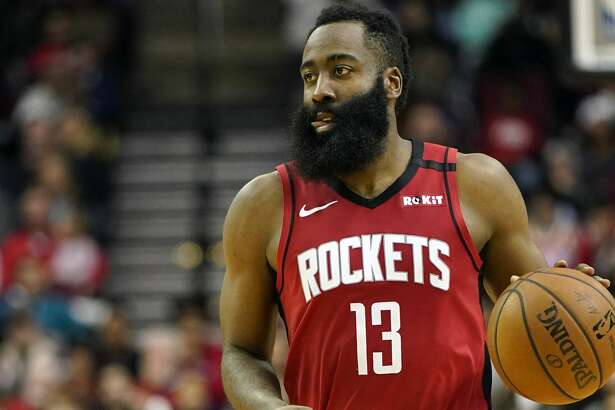 Houston Rockets' James Harden (13) brings the ball up the court against the Denver Nuggets during the second half of an NBA basketball game Wednesday, Jan. 22, 2020, in Houston. (AP Photo/David J. Phillip)