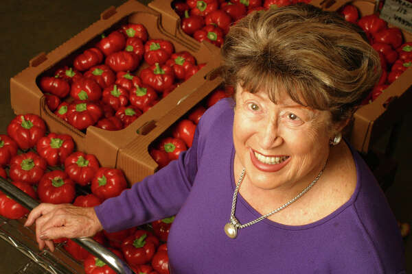 Frieda Caplan, shown here in 2003, displays the toma bella, a pepper and tomato hybrid.