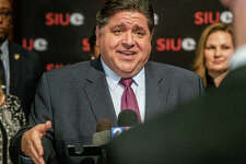 Illinois Gov. JB Pritzker speaks to press Thursday after an event at Southern Illinois University Edwardsville's Meridian Ballroom, where government and school officials announced the release of $10.5 million in funding to develop plans for a $105 million health sciences complex on campus.