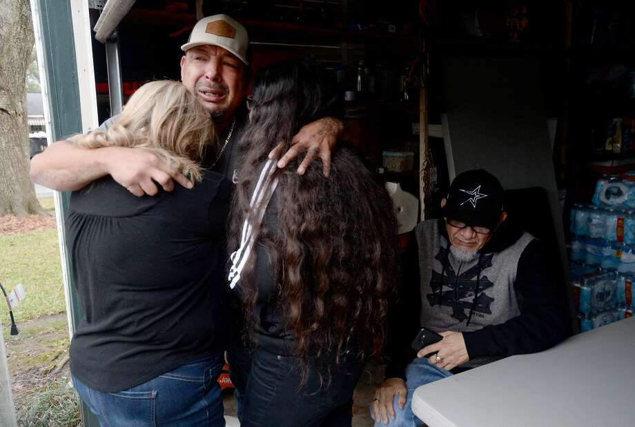 Ray Riojas' older brother Jimmy Moreno hugs sister Delma Castro and niece Delilah Rodriguez as Riojas' father Juan Riojas quietly grieves nearby as the family gather to console one another and grapple with their loss after Riojas was shot and killed at his home on Sunken Court in Port Arthur Wednesday night. Photo taken Thursday, Jan. 23, 2020 Kim Brent/The Enterprise Photo: Kim Brent/The Enterprise