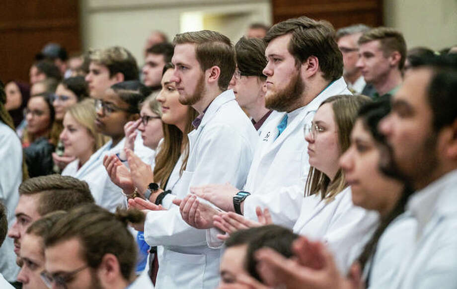 Southern Illinois University Edwardsville School of Pharmacy students applaud Thursday during an event announcing plans to build a $105 million health sciences complex on campus. Photo: Nathan Woodside | Hearst Newspapers