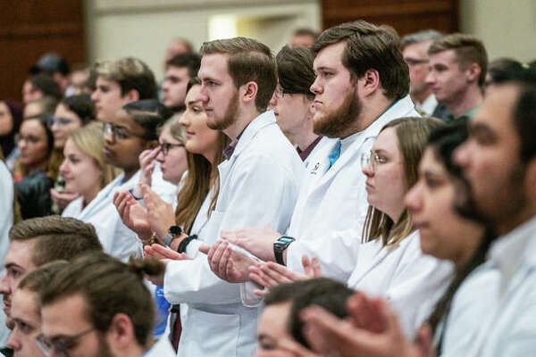Southern Illinois University Edwardsville School of Pharmacy students applaud Thursday during an event announcing plans to build a $105 million health sciences complex on campus.