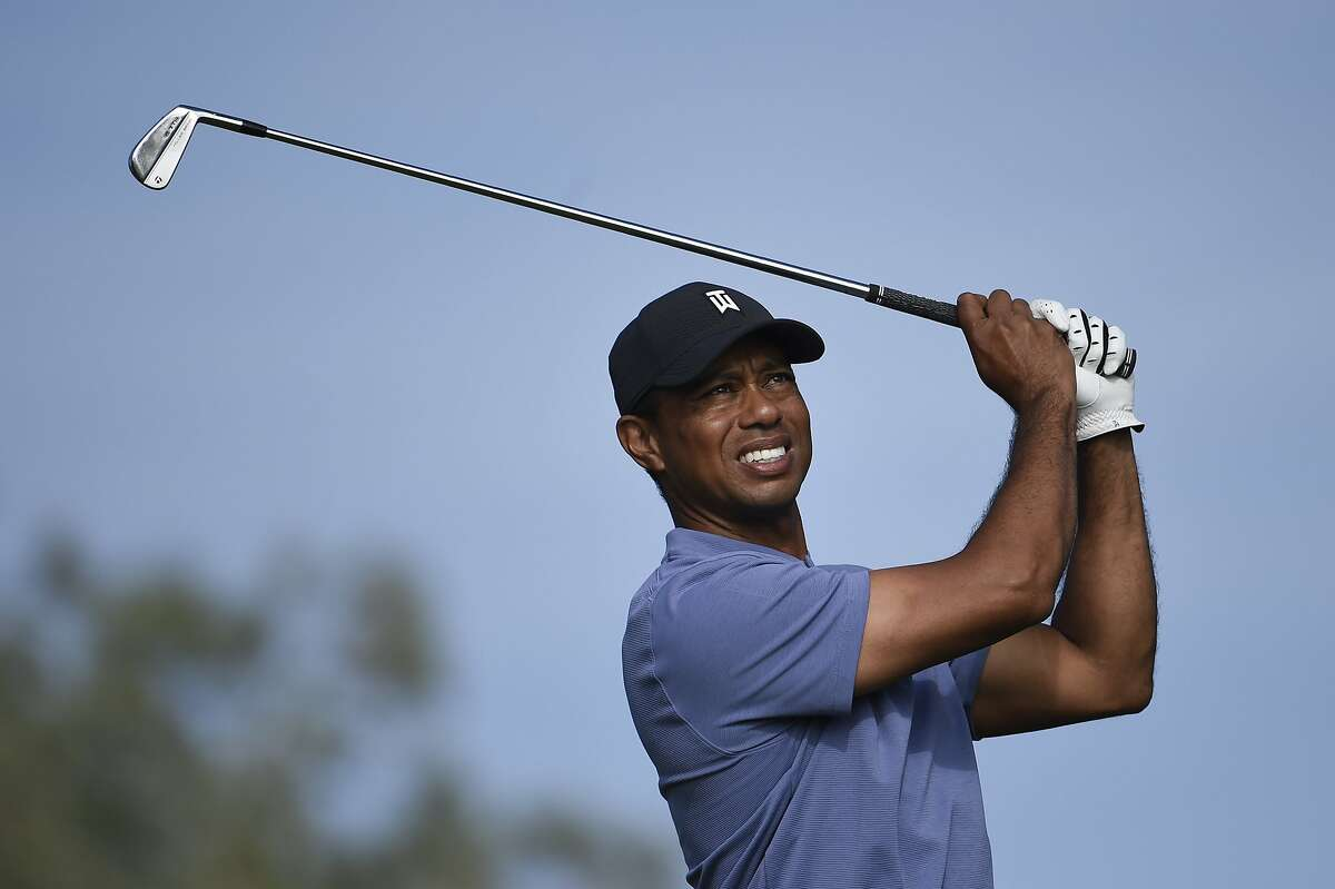 Tiger Woods waits hit his tee shot of the eighth hole of the North Course at Torrey Pines Golf Course during the first round of the Farmers Insurance golf tournament Thursday Jan. 23, 2020, in San Diego. (AP Photo/Denis Poroy)