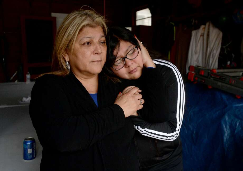 Family of Ray Riojas, including sister Delma Castro and niece Delilah Rodriguez, gather to console one another and share their memories as they continue to grapple with their loss after Riojas was shot and killed at his home on Sunken Court in Port Arthur Wednesday night. Photo taken Thursday, Jan. 23, 2020 Kim Brent/The Enterprise Photo: Kim Brent/The Enterprise