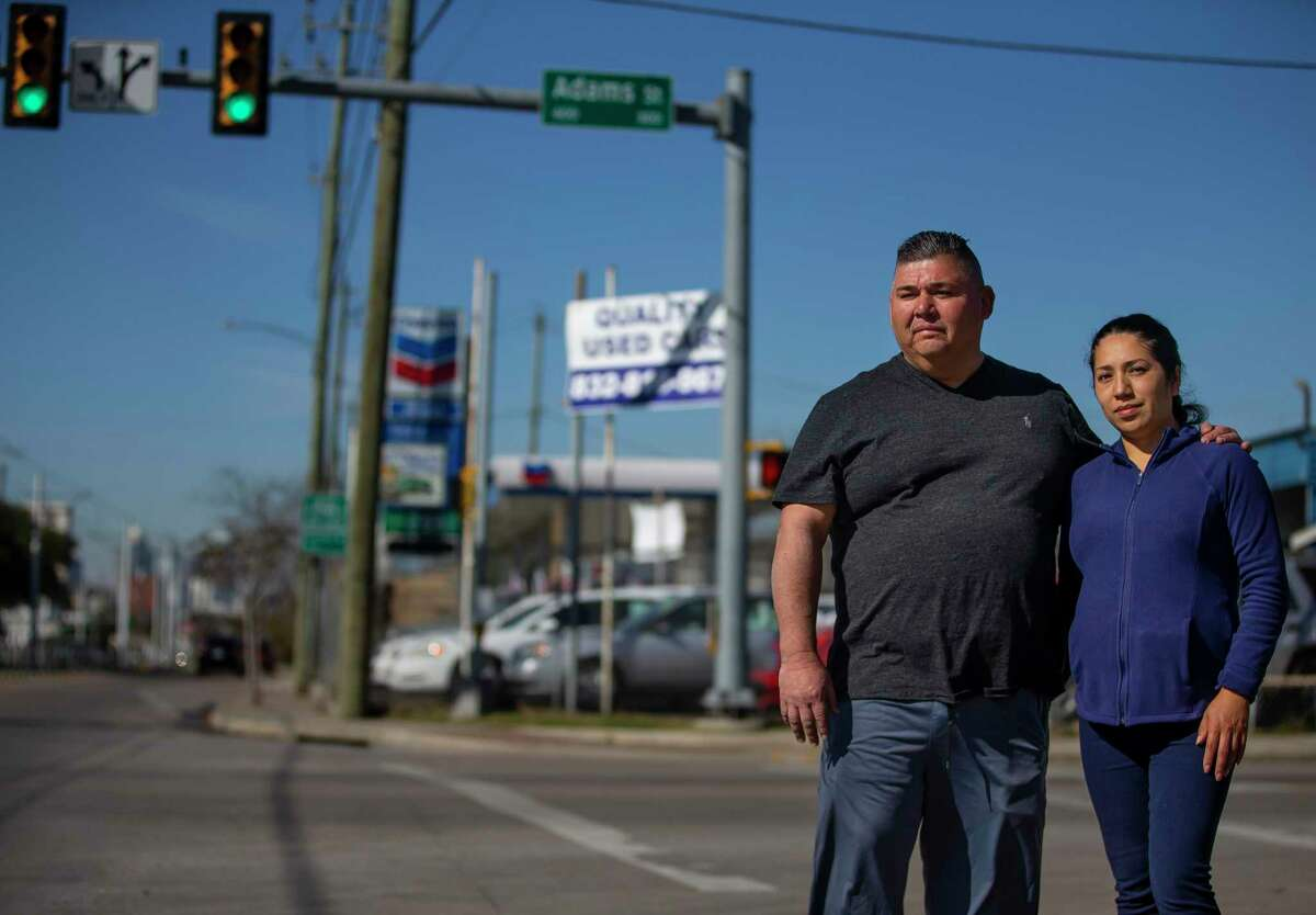 Mark and Yolanda Rodriguez stand along Harrisburg Boulevard where Mark has owned Gulf Coast Used Cars for the past 25 years in the neighborhood where he grew up in the east end of Houston, Thursday, Dec. 19, 2019. Rodriguez has watched the neighborhood change over the past fifty years. Both residents and developers in Houston's East End are fighting to keep the Houston Housing Authority from bringing some 1,400 new apartments -many targeted to lower income Houstonians - to their neighborhood. The area, they say, is already flush with affordable housing and the new projects will remove valuable property from the area's Tax Increment Reinvestment Zone, which uses property tax dollars for public improvements. Moreover, they say, developers will choose other neighborhoods to invest in or cancel projects they were planning in the East End.