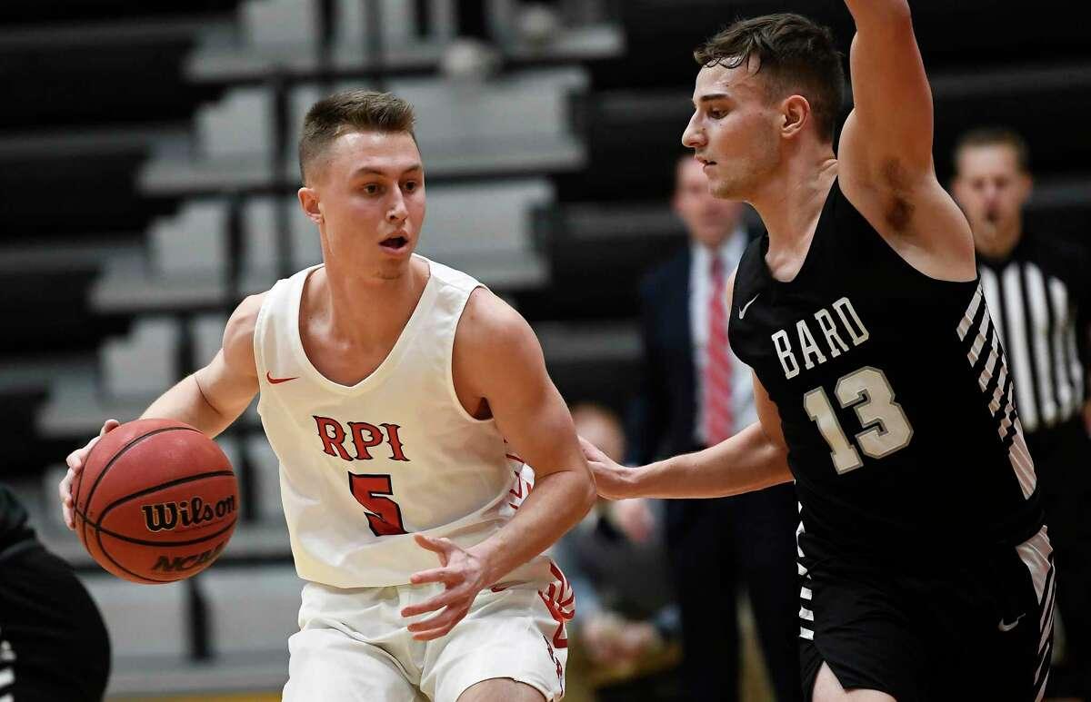 Rensselaer Polytechnic Institute's Cam Bleibtrey (5) against Bard's John Miller during a NCAA basketball game Tuesday, Jan. 21, 2020, in Troy, N.Y. Rensselaer Polytechnic Institute won 89-49.