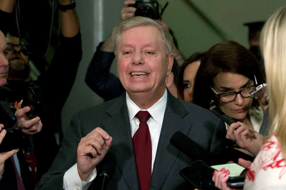 Sen. Lindsey Graham, R-S.C., speaks to the media before attending the impeachment trial of President Donald Trump on charges of abuse of power and obstruction of Congress, Thursday, Jan. 23, 2020, on Capitol Hill in Washington. (AP Photo/Jose Luis Magana)