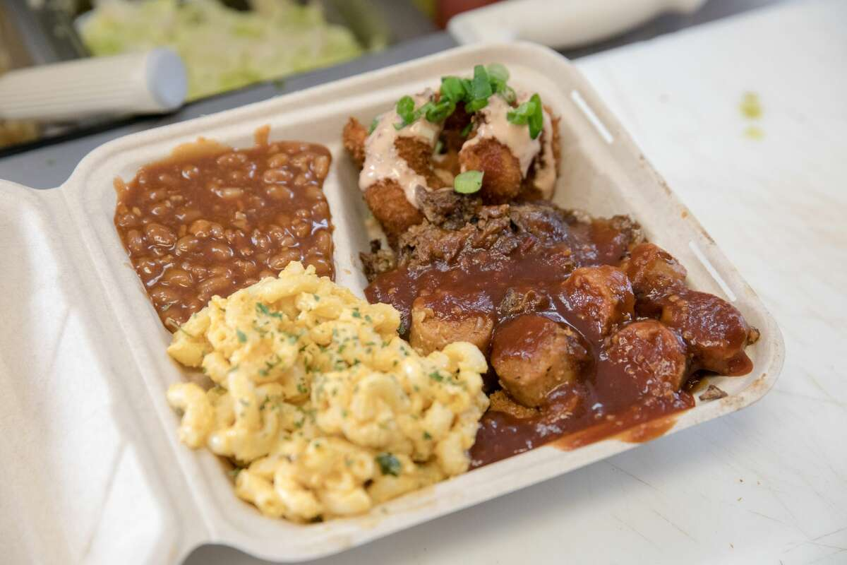 The Vegan Mob Combo Plate, with smoked plant-based brisket, barbecue shrimp and beyond sausage with vegan mac and cheese and barbecue baked beans.