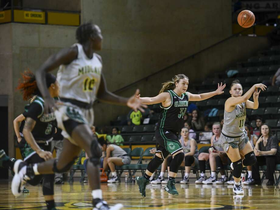 Midland College's Kayla Anderson (11) passes the ball down the court to Nyadouth Lok as Clarendon College's Kelsie Orr guards Anderson on Thursday, Jan. 23, 2020 at Chaparral Center. Photo: Jacy Lewis/Reporter-Telegram